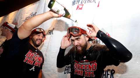 <p>               Atlanta Braves catcher Rene Rivera, left, pours champagne on Ender Inciarte as they celebrate after defeating Philadelphia Phillies 5-3 in a baseball game to clinch the National League East Division, Saturday, Sept. 22, 2018, in Atlanta. (AP Photo/John Bazemore).             </p>