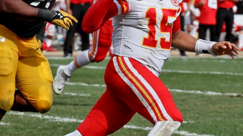 <p>               Kansas City Chiefs quarterback Patrick Mahomes (15) scrambles away from Pittsburgh Steelers defensive end Stephon Tuitt (91) in the second half of an NFL football game, Sunday, Sept. 16, 2018, in Pittsburgh. The Kansas City Chiefs won 42-37. (AP Photo/Gene J. Puskar)             </p>