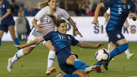 "<p>               FILE - In this Tuesday, Sept. 4, 2018, file photo, United States' Tobin Heath, bottom, scores a goal in front of Chile's Geraldine Leyton during the first half of an international friendly soccer match in San Jose, Calif. Less than a year ago Tobin Heath lamented that being injured was the ""worst thing in the whole entire world."" Now fit, the Portland Thorns and national team midfielder looks like she's having the time of her life. (AP Photo/Jeff Chiu, File)             </p>"