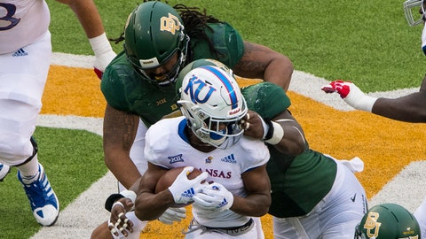 Sep 22, 2018; Waco, TX, USA; The Baylor Bears defense is called for a face mask penalty on Kansas Jayhawks running back Pooka Williams Jr. (1) during the second half at McLane Stadium. Mandatory Credit: Jerome Miron-USA TODAY Sports