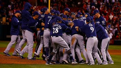 ST. LOUIS, MO - SEPTEMBER 26: Members of the Milwaukee Brewers celebrate after clinching a post-season birth at Busch Stadium on September 26, 2018 in St. Louis, Missouri.  (Photo by Dilip Vishwanat/Getty Images)