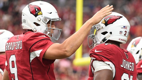 GLENDALE, AZ - SEPTEMBER 23:  Running back David Johnson #31 of the Arizona Cardinals celebrates a 21 yard touchdown with quarterback Sam Bradford #9 in the first half of the NFL game against the Chicago Bears at State Farm Stadium on September 23, 2018 in Glendale, Arizona.  (Photo by Jennifer Stewart/Getty Images)