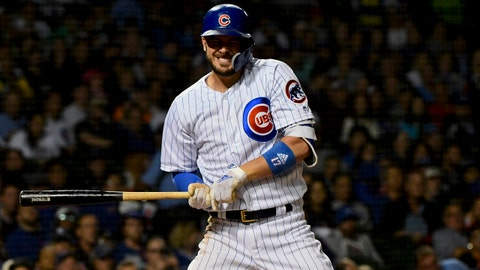 Sep 25, 2018; Chicago, IL, USA; Chicago Cubs third baseman Kris Bryant (17) grimaces after being hit by a pitch delivered by Pittsburgh Pirates starting pitcher Chris Archer (24) in the fourth inning at Wrigley Field. Mandatory Credit: Matt Marton-USA TODAY Sports