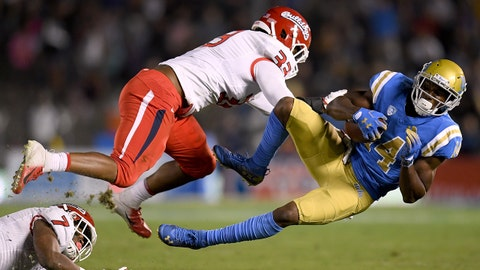 PASADENA, CA - SEPTEMBER 15:  Theo Howard #14 of the UCLA Bruins is tackled by Kwami Jones #33 and James Bailey #7 of the Fresno State Bulldogs during the second quarter at Rose Bowl on September 15, 2018 in Pasadena, California.  (Photo by Harry How/Getty Images)