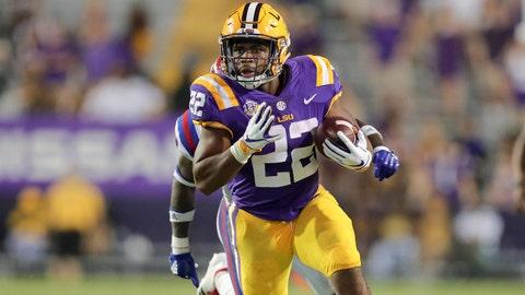 Sep 22, 2018; Baton Rouge, LA, USA; LSU Tigers running back Clyde Edwards-Helaire (22) avoids the tackle of  Louisiana Tech Bulldogs safety Daniel Lewis Jr. (14) at Tiger Stadium. Mandatory Credit: Stephen Lew-USA TODAY Sports