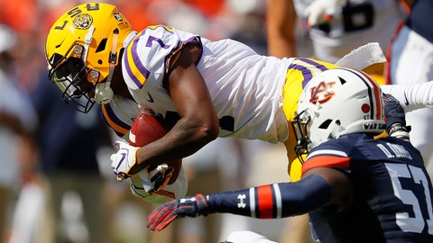AUBURN, AL - SEPTEMBER 15:  Jonathan Giles #7 of the LSU Tigers dives for more yardage against Deshaun Davis #57 of the Auburn Tigers at Jordan-Hare Stadium on September 15, 2018 in Auburn, Alabama.  (Photo by Kevin C. Cox/Getty Images)