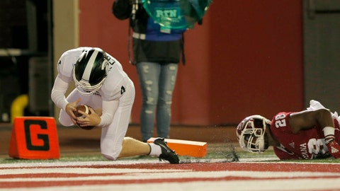 BLOOMINGTON, IN - SEPTEMBER 22: Michigan State Spartans kicker Matt Coghlin (4) dives in for the touchdown off the fake field goal attempt  during the game between the Michigan State Spartans and the Indiana Hoosiers on September 22, 2018 at Memorial Stadium in Bloomington IN. The Michigan State Spartans defeated the Indiana Hoosiers 35-21.  (Photo by Jeffrey Brown/Icon Sportswire via Getty Images)