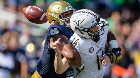 SOUTH BEND, IN - SEPTEMBER 15: Notre Dame Fighting Irish defensive lineman Jerry Tillery (99) sacks Vanderbilt Commodores quarterback Kyle Shurmur (14) causing a fumble in the 2nd quarter during a college football game between the Vanderbilt Commodores and the Notre Dame Fighting Irish on September 15, 2018, at Notre Dame Stadium in South Bend, IN. (Photo by Daniel Bartel/Icon Sportswire via Getty Images)