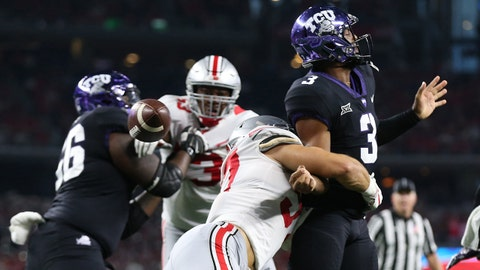 Sep 15, 2018; Arlington, TX, USA; Texas Christian Horned Frogs quarterback Shawn Robinson (3) has the ball stripped by Ohio State Buckeyes defensive end Nick Bosa (97) at AT&T Stadium. Mandatory Credit: Matthew Emmons-USA TODAY Sports