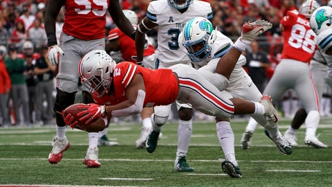 Sep 22, 2018; Columbus, OH, USA; Ohio State Buckeyes running back J.K. Dobbins (2) leaps to score a touchdown against the Tulane Green Wave in the first half at Ohio Stadium. Mandatory Credit: Aaron Doster-USA TODAY Sports