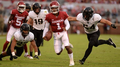 Sep 22, 2018; Norman, OK, USA; Oklahoma Sooners quarterback Kyler Murray (1) eludes tackle attempts by Army Black Knights defensive back Elijah Riley (23) and linebacker Cole Christiansen (54) during the second quarter at Gaylord Family - Oklahoma Memorial Stadium. Mandatory Credit: Mark D. Smith-USA TODAY Sports