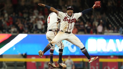 Sep 14, 2018; Atlanta, GA, USA; Atlanta Braves left fielder Ronald Acuna Jr. (13) and second baseman Ozzie Albies (1) celebrate after defeating the Washington Nationals at SunTrust Park. Mandatory Credit: Jason Getz-USA TODAY Sports