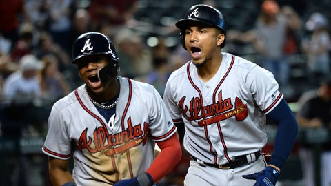 Sep 9, 2018; Phoenix, AZ, USA; Atlanta Braves third baseman Johan Camargo (right) celebrates a two-run home run against the Arizona Diamondbacks with Atlanta Braves left fielder Ronald Acuna Jr. (left) during the ninth inning against the Arizona Diamondbacks at Chase Field. Mandatory Credit: Joe Camporeale-USA TODAY Sports