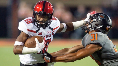 Sep 22, 2018; Stillwater, OK, USA;  Texas Tech Red Raiders wide receiver Ja'Deion High (88) fights off Oklahoma State Cowboys safety Kolby Peel (31) during the game at Boone Pickens Stadium. Mandatory Credit: Brett Rojo-USA TODAY Sports