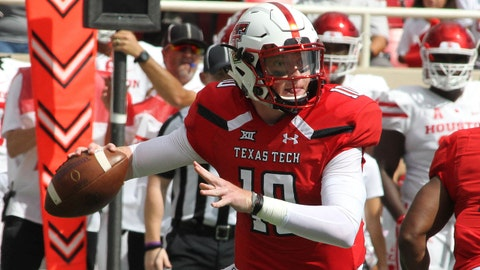 Sep 15, 2018; Lubbock, TX, USA; Texas Tech Red Raiders quarterback Alan Bowman (10) looks for an open receiver against the Houston Cougars in the first half at Jones AT&T Stadium. Mandatory Credit: Michael C. Johnson-USA TODAY Sports