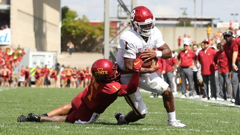 Sep 15, 2018; Ames, IA, USA; Iowa State Cyclones defensive back D'Andre Payne (1) tackles Oklahoma Sooners quarterback Kyler Murray (1) at Jack Trice Stadium. Mandatory Credit: Reese Strickland-USA TODAY Sports