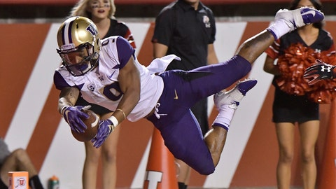 SALT LAKE CITY, UT - SEPTEMBER 15: Myles Gaskin #9 of the Washington Huskies leaps into the end zone for a touchdown in the first half of a game against the Utah Utes at Rice-Eccles Stadium on September 15, 2018 in Salt Lake City, Utah. (Photo by Gene Sweeney Jr/Getty Images)