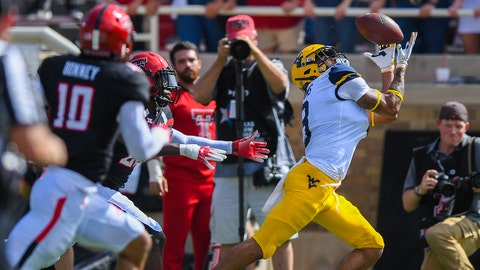 LUBBOCK, TX - SEPTEMBER 29: Marcus Simms #8 of the West Virginia Mountaineers makes the catch during the first half of the game against the Texas Tech Red Raiders on September 29, 2018 at Jones AT&T Stadium in Lubbock, Texas. (Photo by John Weast/Getty Images)