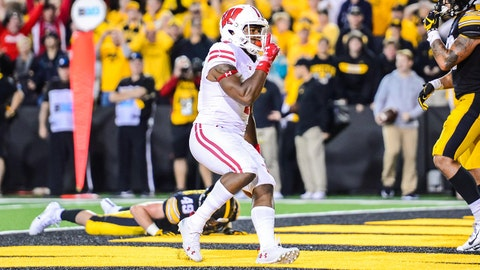 Sep 22, 2018; Iowa City, IA, USA; Wisconsin Badgers wide receiver A.J. Taylor (4) reacts after catching a touchdown pass against the Iowa Hawkeyes during the fourth quarter at Kinnick Stadium. Mandatory Credit: Jeffrey Becker-USA TODAY Sports