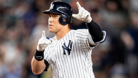 NEW YORK, NY - SEPTEMBER 19: Aaron Judge #99 of the New York Yankees reacts after reaching on an RBI error during the second inning of a game against the Boston Red Sox on September 19, 2018 at Yankee Stadium in the Bronx borough of New York City. (Photo by Billie Weiss/Boston Red Sox/Getty Images)
