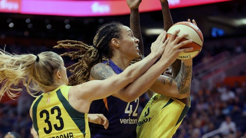 <p>               Phoenix Mercury center Brittney Griner (42) is guarded by Seattle Storm's Sami Whitcomb (33) and Natasha Howard as she tries to drive to the basket during the first half of Game 4 of a WNBA basketball semifinals playoff game, Sunday, Sept. 2, 2018, in Phoenix. (AP Photo/Ralph Freso)             </p>