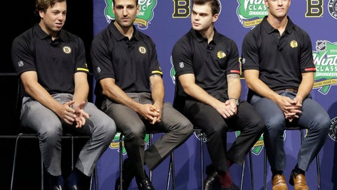 <p>               Boston Bruins' Charlie McAvoy, left, speaks as teammate Patrice Bergeron, second from left, and Chicago Blackhawks' Alex DeBrincat and Jonathan Toews, right, listen during a news conference Thursday, Sept. 6, 2018, in Chicago about the NHL Winter Classic hockey game. The Bruins will play the Blackhawks at Notre Dame Stadium on New Year's Day in South Bend, Ind. (AP Photo/Nam Y. Huh)             </p>