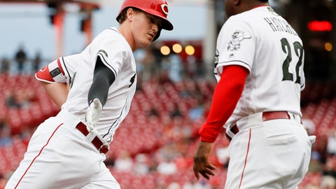 <p>               Cincinnati Reds' Brandon Dixon, left, celebrates with third base coach Billy Hatcher (22) after hitting a solo home run off Los Angeles Dodgers starting pitcher Hyun-Jin Ryu in the second inning of a baseball game, Tuesday, Sept. 11, 2018, in Cincinnati. (AP Photo/John Minchillo)             </p>