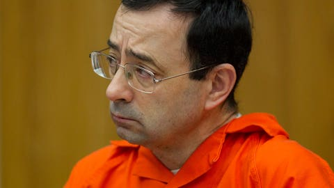 <p>               FILE - In this Jan. 31, 2018 file photo, Larry Nassar appears for his sentencing at Eaton County Circuit Court in Charlotte, Mich. The Justice Department's inspector general is investigating how the FBI handled sexual abuse allegations against the former USA Gymnastics national team doctor, a person familiar with the matter said Wednesday, Sept. 5 The investigation comes amid allegations that the FBI had failed to promptly address complaints made in 2015 against Nasser, a once-renowned gymnastics doctor. Nassar is now serving decades in prison after hundreds of girls and women said he sexually abused them under the guise of medical treatment when he worked for Michigan State and Indiana-based USA Gymnastics, which trains Olympians. (Cory Morse /The Grand Rapids Press via AP, File)             </p>