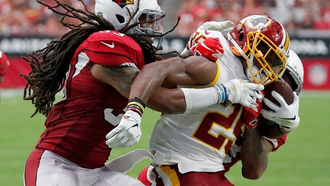<p>               Washington Redskins running back Chris Thompson, center, is hit by Arizona Cardinals defensive back Tre Boston, left, during the first half of an NFL football game, Sunday, Sept. 9, 2018, in Glendale, Ariz. (AP Photo/Rick Scuteri)             </p>