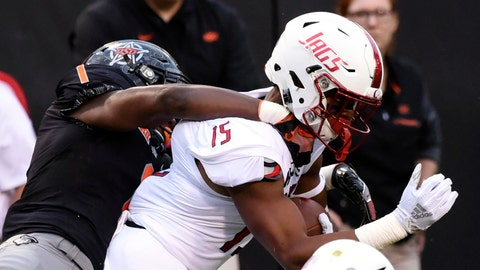 <p>               South Alabama wide receiver Kawaan Baker (15) is tackled by Oklahoma State linebacker Calvin Bundage (1) during an NCAA college football game in Stillwater, Okla., Saturday, Sept. 8, 2018. (AP Photo/Brody Schmidt)             </p>