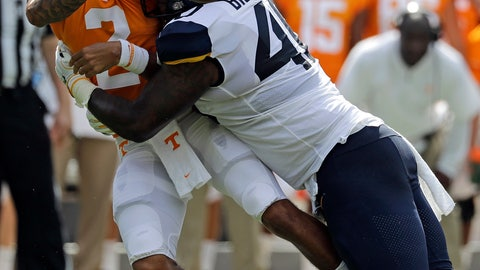 <p>               Tennessee's Jarrett Guarantano (2) loses the ball as he is hit by West Virginia's Kenny Bigelow Jr. (40) in the first half of an NCAA college football game in Charlotte, N.C., Saturday, Sept. 1, 2018. The play was ruled an incomplete pass. (AP Photo/Chuck Burton)             </p>