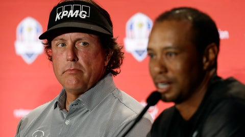 <p>               Phil Mickelson, left, listens to Tiger Woods speak during a news conference where they were announced as captain's picks for the 2018 U.S. Ryder Cup Team, Tuesday, Sept. 4, 2018, in West Conshohocken, Pa. (AP Photo/Matt Slocum)             </p>