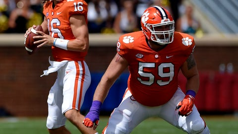 <p>               Clemson quarterback Trevor Lawrence drops back to pass with blocking help from Gage Cervenka (59) during the first half of an NCAA college football game against Georgia Southern, Saturday, Sept. 15, 2018, in Clemson, S.C. (AP Photo/Richard Shiro)             </p>