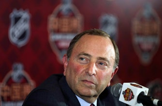 Bruins use shootout to top Flames in preseason opener