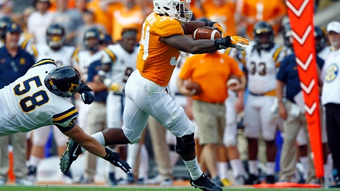 <p>               FILE - In this Sept. 8, 2018, file photo, Tennessee linebacker Darrin Kirkland Jr. (34) returns an interception for a touchdown as East Tennessee State University's Greg McCloud (58) tries to make the tackle during an NCAA college football game in Knoxville, Tenn. Statistics suggest Tennessee's defense has improved quite a bit the last couple of weeks and heads into Southeastern Conference competition with momentum. Tennessee coach Jeremy Pruitt sees it differently. (AP Photo/Wade Payne, File)             </p>