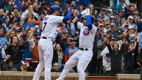 <p>               Chicago Cubs' Kris Bryant (17) and Willson Contreras, right, high five after they score on Contreras' home run during the fifth inning of a baseball game against the St. Louis Cardinals on Sunday, Sept. 30, 2018, in Chicago. (AP Photo/Matt Marton)             </p>