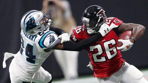 <p>               Atlanta Falcons running back Tevin Coleman (26) runs against Carolina Panthers cornerback James Bradberry (24) during the second half of an NFL football game, Sunday, Sept. 16, 2018, in Atlanta. (AP Photo/John Bazemore)             </p>