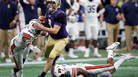 <p>               Washington quarterback Jake Browning (3) is stopped by Auburn's Darrell Williams (49) and Jeremiah Dinson (20) after running for a first down during the second half of an NCAA college football game Saturday, Sept. 1, 2018, in Atlanta. Auburn won 21-16. (AP Photo/John Bazemore)             </p>