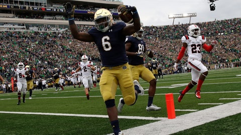 <p>               Notre Dame running back Tony Jones Jr (6) celebrates as he runs in a touchdown against Ball State during the first half of an NCAA college football game in South Bend, Ind., Saturday, Sept. 8, 2018. (AP Photo/Nam Y. Huh)             </p>