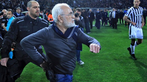 <p>               FILE - In this Sunday, March 11, 2018 file photo PAOK owner, businessman Ivan Savvidis invades the pitch with a gun strapped to his belt during a Greek League soccer match between PAOK and AEK Athens in the northern Greek city of Thessaloniki. After this match the league was suspended for two weeks, and FIFA forced Greece to make urgent reforms or face expulsion from international competition, including importing international referees for controversial matches involving major clubs where there is a potential for violence. (InTime Sports via AP, File)             </p>