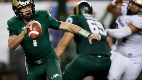 <p>               FILE--In this Friday, Aug. 31, 2018, file photograph, Colorado State quarterback K.J. Carta-Samuels rolls out to pass under pressure during the second half of an NCAA college football game against Colorado in Denver. Colorado won 45-13. Carta-Samuels and the Rams will host Arkansas on Saturday. (AP Photo/David Zalubowski, File)             </p>