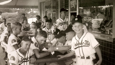 """<p>               This image provided by Common Pictures shows the 1955 Orlando Kiwanis little league baseball team. In 1955, one of the most significant games in American history took place in Orlando, Fla, but hardly anyone knows about it. For the first time, an integrated Little League Baseball game, a group of white kids playing a team of African-American youngsters, was held in the Jim Crow South. The new documentary """"Long Time Coming: A 1955 Baseball Story"""" has brought this amazing snippet in the American experience back to life. (via AP)             </p>"""