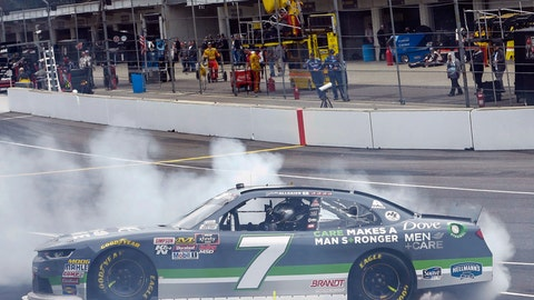 <p>               Justin Allgaier (7) does a burnout after winning the NASCAR Xfinity Series auto race at Indianapolis Motor Speedway, in Indianapolis, Monday, Sept. 10, 2018. (AP Photo/AJ Mast)             </p>