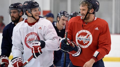 <p>               Washington Capitals left wing Alex Ovechkin, right, of Russia, laughs with Nic Dowd, left, as they leave the ice at NHL hockey training camp, Friday, Sept. 14, 2018, in Arlington, Va. (AP Photo/Nick Wass)             </p>