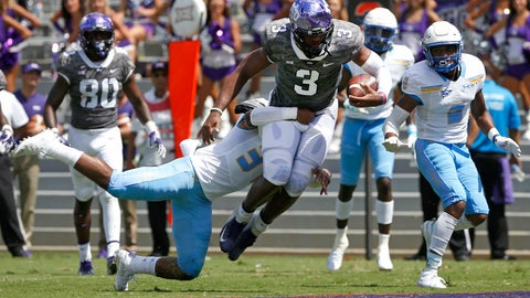 <p>               TCU quarterback Shawn Robinson (3) lunges across the goal line for a touchdown as Southern University safety Cordell Caldwell tries to stop him during the first half of an NCAA college football game Saturday, Sept. 1, 2018, in Fort Worth, Texas. (AP Photo/Ron Jenkins)             </p>