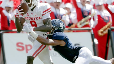 <p>               Houston wide receiver Courtney Lark (9) pulls in the reception for a touchdown in front of Rice cornerback Justin Bickham, right, during the first half of a NCAA college football game Saturday, Sep. 1, 2018, in Houston. (AP Photo/Michael Wyke)             </p>