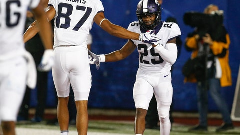 <p>               TCU wide receiver KaVontae Turpin (25) celebrates his touchdown with wide receiver TreVontae Hights (87) during the second quarter against SMU in an NCAA college football game Friday, Sept. 7, 2018, in Dallas. (AP Photo/Jim Cowsert)             </p>