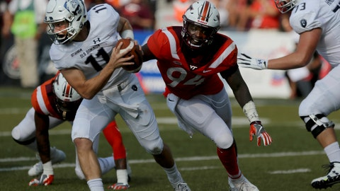 <p>               Old Dominion quarterback Blake LaRussa is flushed out of the pocket by Virginia Tech's Trevon Hill during the second half of an NCAA college football game, Saturday, Sept. 22, 2018, in Norfolk, Va. Old Dominion won 49-35. (AP Photo/Jason Hirschfeld)             </p>