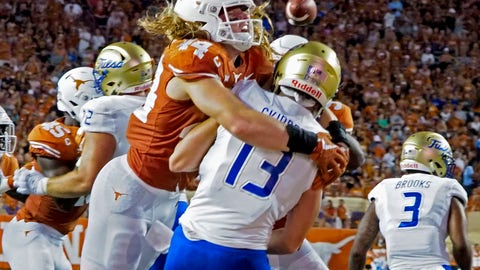 <p>               Texas lineman Breckyn Hager (44) hits Tulsa quarterback Luke Skipper (13) during the first half of an NCAA college football game Saturday, Sept. 8, 2018, in Austin, Texas. Hager was called for roughing. (AP Photo/Michael Thomas)             </p>