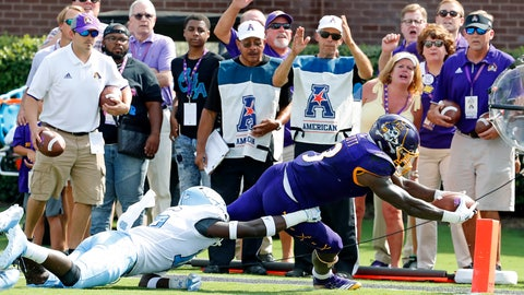 <p>               East Carolina's Anthony Scott (3) stretches for the goal line in the arms of North Carolina's D.J. Ford (16) during the first half of an NCAA college football game in Greenville, N.C., Saturday, Sept. 8, 2018. (AP Photo/Karl B DeBlaker)             </p>